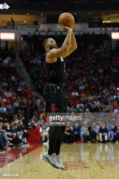 Eric Gordon of the Houston Rockets shoots a three point shot against the New Orleans Pelicans in the first half at Toyota Center on December 11 2017...