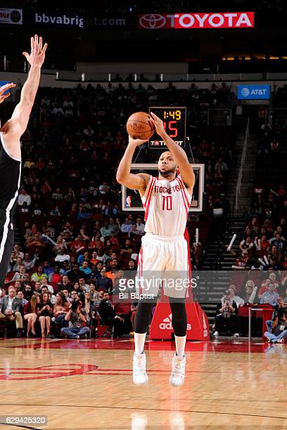 Eric Gordon of the Houston Rockets shoots the ball against the Brooklyn Nets on December 12 2016 at the Toyota Center in Houston Texas NOTE TO USER...