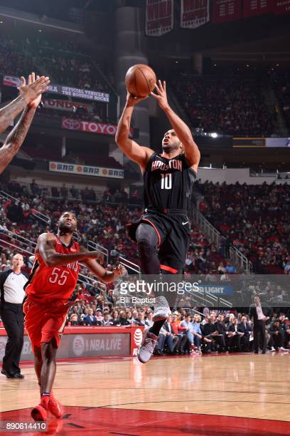 Eric Gordon of the Houston Rockets shoots the ball against the New Orleans Pelicans on December 11 2017 at the Toyota Center in Houston Texas NOTE TO...