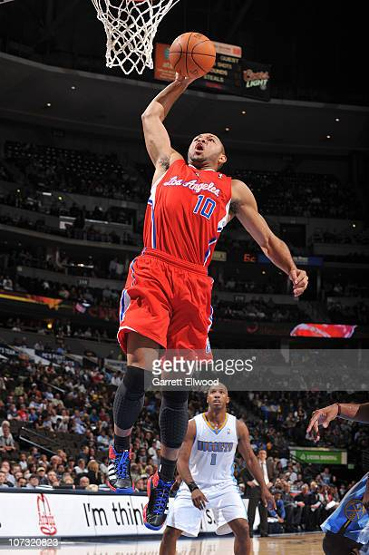 Eric Gordon of the Los Angeles Clippers goes to the basket against the Denver Nuggets on December 3 2010 at the Pepsi Center in Denver Colorado NOTE...