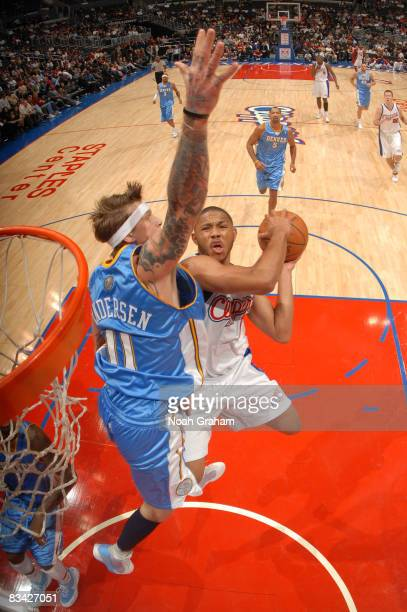 Eric Gordon of the Los Angeles Clippers has his shot contested by Chris Andersen of the Denver Nuggets at Staples Center on October 24 2008 in Los...