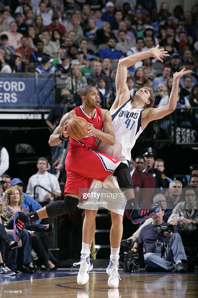 Eric Gordon #10 of the Los Angeles Clippers looks to pass against Dirk Nowitzki #41 of the Dallas Mavericks during the game on April 8, 2011 at the American Airlines Center in Dallas, Texas.