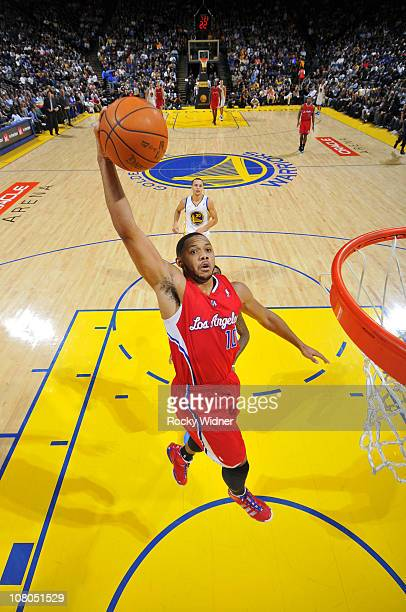 Eric Gordon of the Los Angeles Clippers soars through the air for a dunk in a game against the Golden State Warriors on January 14 2011 at Oracle...