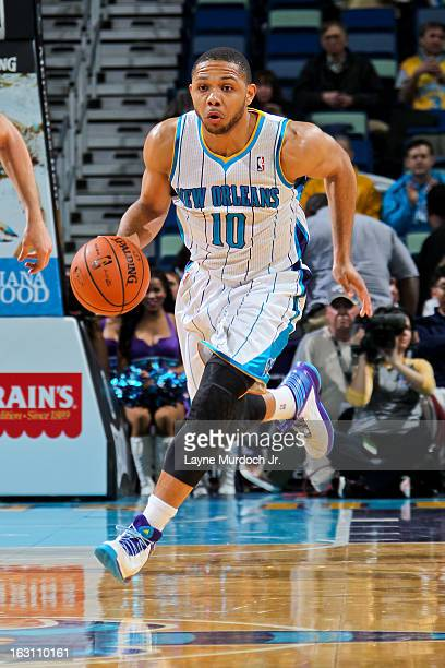 Eric Gordon of the New Orleans Hornets advances the ball against the Orlando Magic on March 4 2013 at the New Orleans Arena in New Orleans Louisiana...