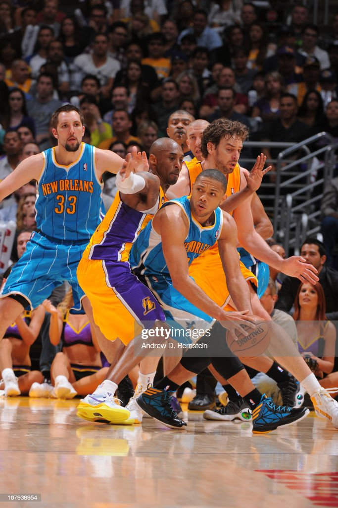Eric Gordon #10 of the New Orleans Hornets attempts to pass the ball against Kobe Bryant #24 of the Los Angeles Lakers at Staples Center on April 9, 2013 in Los Angeles, California.