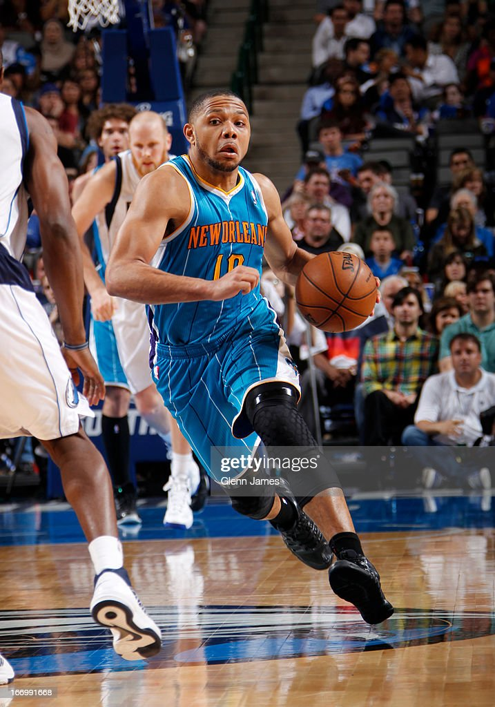 Eric Gordon #10 of the New Orleans Hornets brings the ball up court against the Dallas Mavericks on April 17, 2013 at the American Airlines Center in Dallas, Texas.