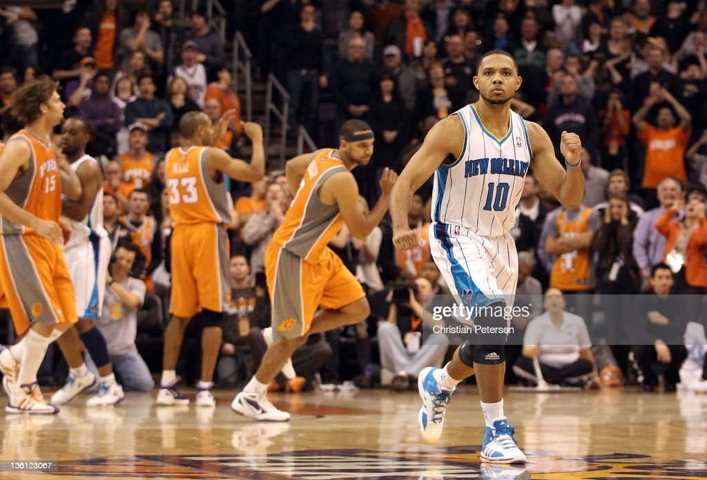 <a gi-track='captionPersonalityLinkClicked' href=/galleries/search?phrase=Eric+Gordon&family=editorial&specificpeople=4212733 ng-click='$event.stopPropagation()'>Eric Gordon</a> #10 of the New Orleans Hornets celebrates after scoring the game winning basket against the Phoenix Suns during the season openning NBA game at US Airways Center on December 26, 2011 in Phoenix, Arizona. The Hornets defeated the Suns 85-84.