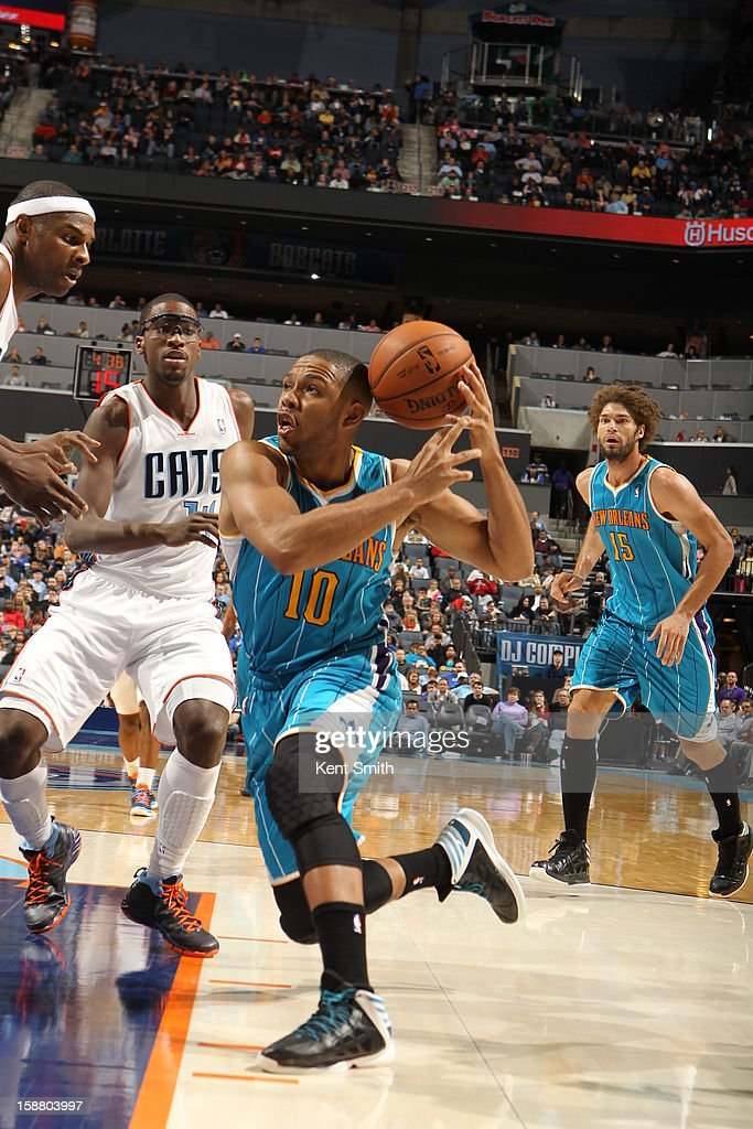 Eric Gordon #10 of the New Orleans Hornets drives against Michael Kidd-Gilchrist #14 of the Charlotte Bobcats at the Time Warner Cable Arena on December 29, 2012 in Charlotte, North Carolina.
