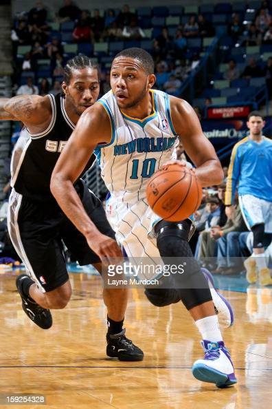 Eric Gordon of the New Orleans Hornets drives against the San Antonio Spurs on January 7 2013 at the New Orleans Arena in New Orleans Louisiana NOTE...