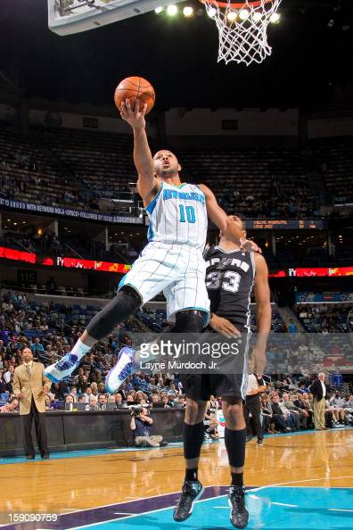 Eric Gordon of the New Orleans Hornets drives to the basket against Boris Diaw of the San Antonio Spurs on January 7 2013 at the New Orleans Arena in...