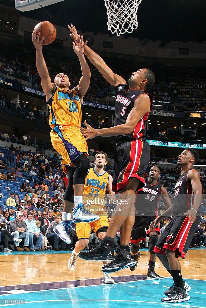 <a gi-track='captionPersonalityLinkClicked' href=/galleries/search?phrase=Eric+Gordon&family=editorial&specificpeople=4212733 ng-click='$event.stopPropagation()'>Eric Gordon</a> #10 of the New Orleans Hornets drives to the basket against the Miami Heat on March 29, 2013 at the New Orleans Arena in New Orleans, Louisiana.