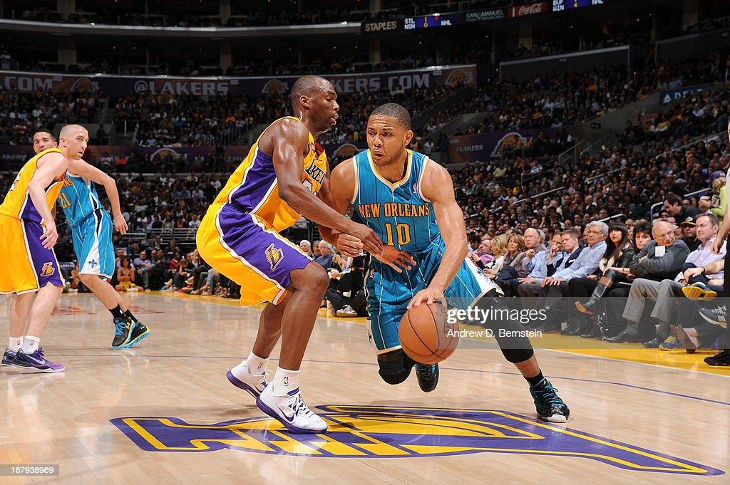 Eric Gordon #10 of the New Orleans Hornets drives to the basket against the Los Angeles Lakers at Staples Center on April 9, 2013 in Los Angeles, California.