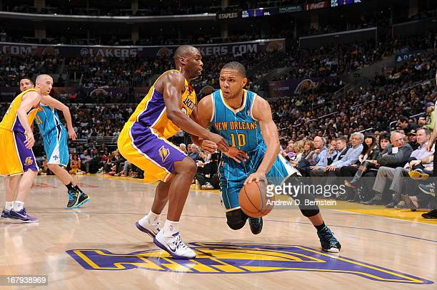 Eric Gordon of the New Orleans Hornets drives to the basket against the Los Angeles Lakers at Staples Center on April 9 2013 in Los Angeles...