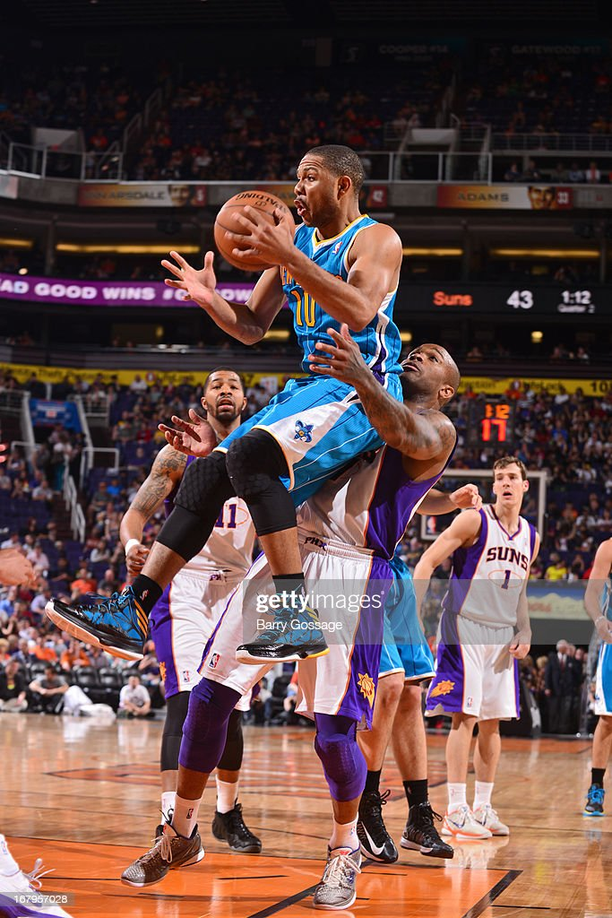<a gi-track='captionPersonalityLinkClicked' href=/galleries/search?phrase=Eric+Gordon+-+Basketball+Player&family=editorial&specificpeople=4212733 ng-click='$event.stopPropagation()'>Eric Gordon</a> #10 of the New Orleans Hornets drives to the basket against the Phoenix Suns on April 7, 2013 at U.S. Airways Center in Phoenix, Arizona.