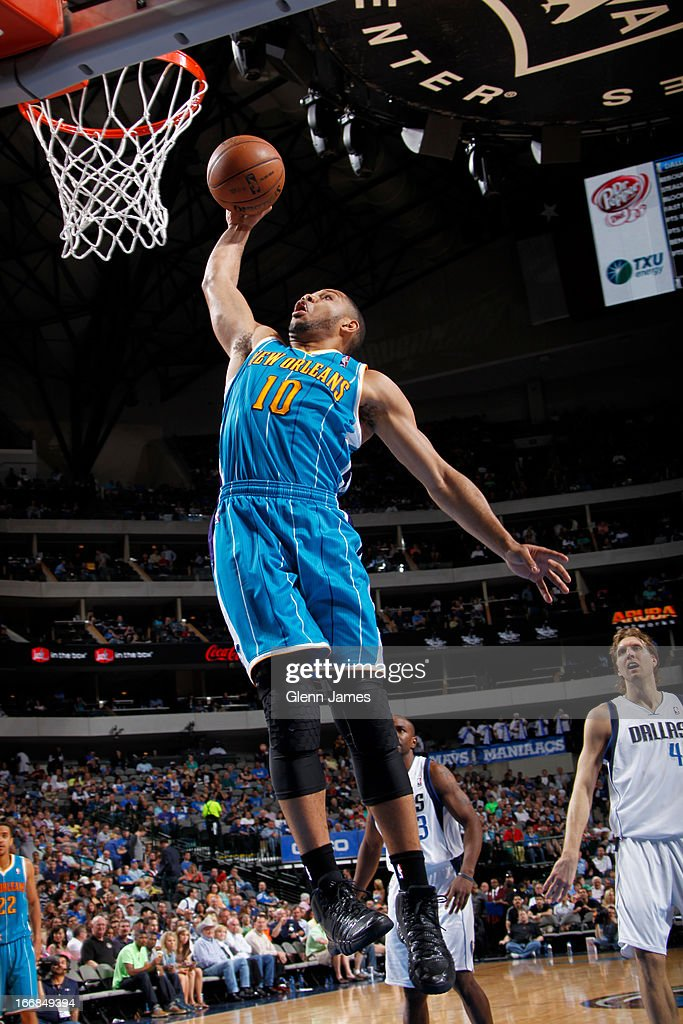 Eric Gordon #10 of the New Orleans Hornets dunks against the Dallas Mavericks on April 17, 2013 at the American Airlines Center in Dallas, Texas.