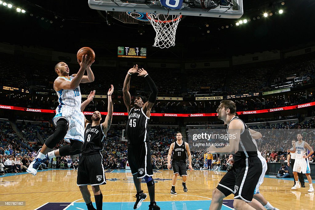 <a gi-track='captionPersonalityLinkClicked' href=/galleries/search?phrase=Eric+Gordon&family=editorial&specificpeople=4212733 ng-click='$event.stopPropagation()'>Eric Gordon</a> #10 of the New Orleans Hornets goes to the basket against <a gi-track='captionPersonalityLinkClicked' href=/galleries/search?phrase=Deron+Williams&family=editorial&specificpeople=203215 ng-click='$event.stopPropagation()'>Deron Williams</a> #8 and <a gi-track='captionPersonalityLinkClicked' href=/galleries/search?phrase=Gerald+Wallace&family=editorial&specificpeople=202117 ng-click='$event.stopPropagation()'>Gerald Wallace</a> #45 of the Brooklyn Nets on February 26, 2013 at the New Orleans Arena in New Orleans, Louisiana.