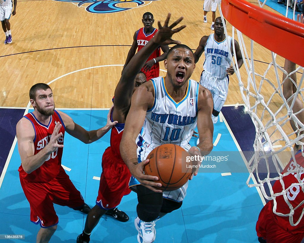 Eric Gordon #10 of the New Orleans Hornets goes to the basket under pressure during an NBA game between the Philadelphia 76ers and the New Orleans Hornets on January 4, 2012 at the New Orleans Arena in New Orleans, Louisiana.