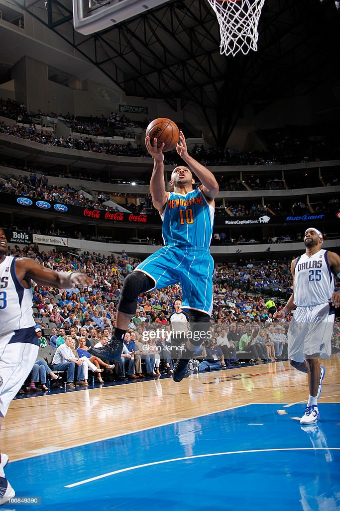 Eric Gordon #10 of the New Orleans Hornets lays the ball up against Mike James #13 of the Dallas Mavericks on April 17, 2013 at the American Airlines Center in Dallas, Texas.