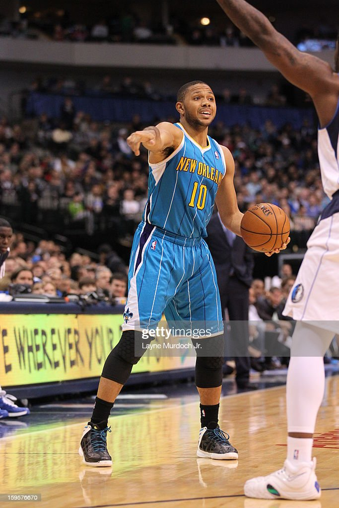 <a gi-track='captionPersonalityLinkClicked' href=/galleries/search?phrase=Eric+Gordon&family=editorial&specificpeople=4212733 ng-click='$event.stopPropagation()'>Eric Gordon</a> #10 of the New Orleans Hornets looks to pass the ball against the Dallas Mavericks on January 05, 2012 at the American Airlines Center in Dallas, Texas.