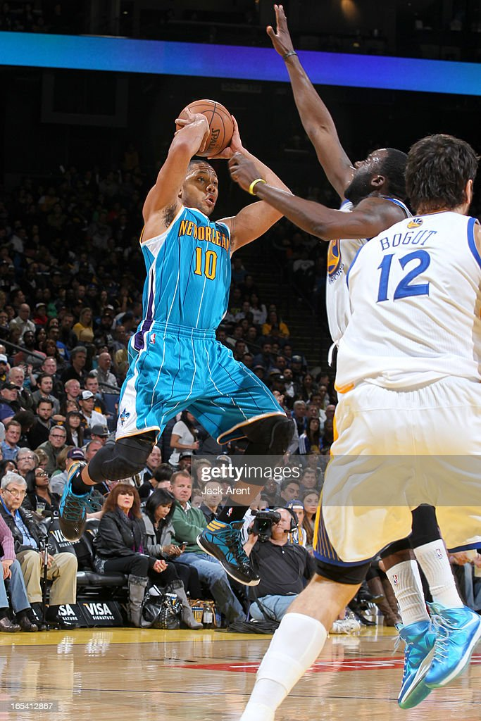<a gi-track='captionPersonalityLinkClicked' href=/galleries/search?phrase=Eric+Gordon&family=editorial&specificpeople=4212733 ng-click='$event.stopPropagation()'>Eric Gordon</a> #10 of the New Orleans Hornets looks to pass the ball against <a gi-track='captionPersonalityLinkClicked' href=/galleries/search?phrase=Draymond+Green&family=editorial&specificpeople=5628054 ng-click='$event.stopPropagation()'>Draymond Green</a> #23 of the Golden State Warriors on April 3, 2013 at Oracle Arena in Oakland, California.