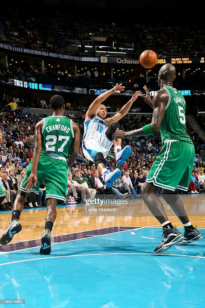 Eric Gordon #10 of the New Orleans Hornets passes the ball against Kevin Garnett #5 of the Boston Celtics on March 20, 2013 at the New Orleans Arena in New Orleans, Louisiana.