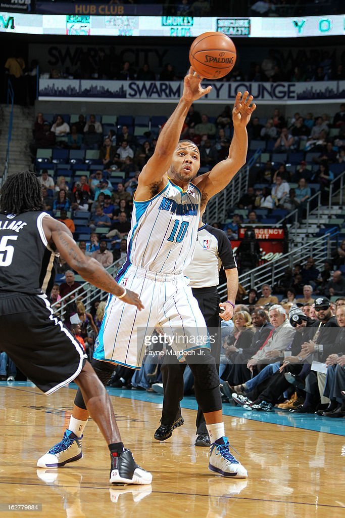 Eric Gordon #10 of the New Orleans Hornets passes the ball against the Brooklyn Nets on February 26, 2013 at the New Orleans Arena in New Orleans, Louisiana.