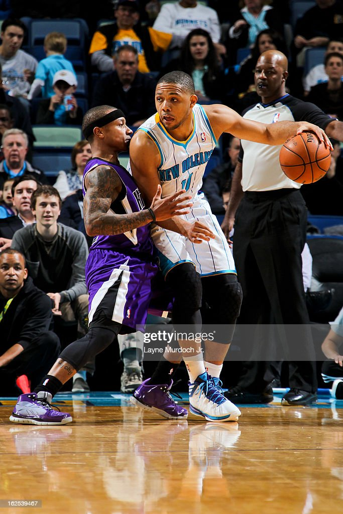Eric Gordon #10 of the New Orleans Hornets posts-up against Isaiah Thomas #22 of the Sacramento Kings on February 24, 2013 at the New Orleans Arena in New Orleans, Louisiana.