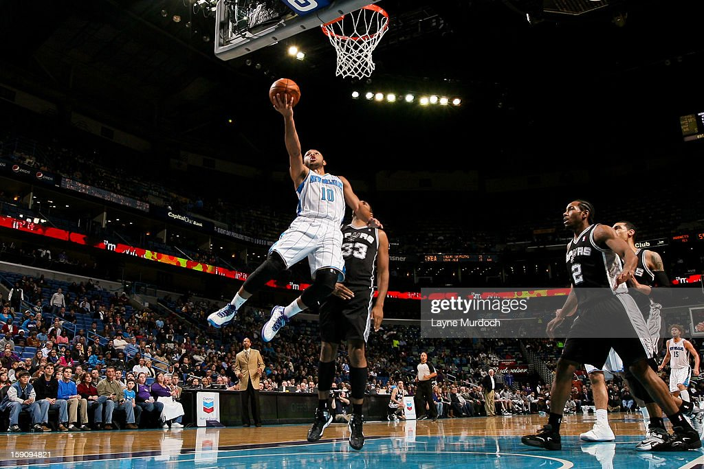 Eric Gordon #10 of the New Orleans Hornets shoots a layup against Boris Diaw #33 of the San Antonio Spurs on January 7, 2013 at the New Orleans Arena in New Orleans, Louisiana.