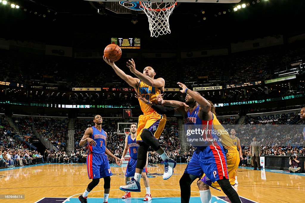 Eric Gordon #10 of the New Orleans Hornets shoots a layup against Greg Monroe #10 of the Detroit Pistons on March 1, 2013 at the New Orleans Arena in New Orleans, Louisiana.