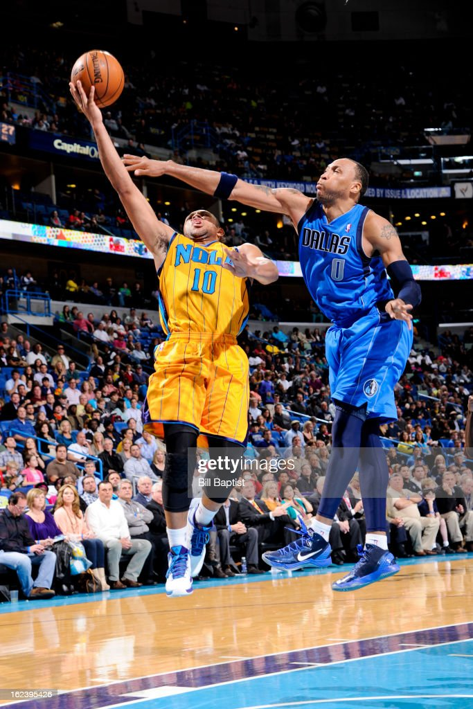 <a gi-track='captionPersonalityLinkClicked' href=/galleries/search?phrase=Eric+Gordon&family=editorial&specificpeople=4212733 ng-click='$event.stopPropagation()'>Eric Gordon</a> #10 of the New Orleans Hornets shoots a layup against <a gi-track='captionPersonalityLinkClicked' href=/galleries/search?phrase=Shawn+Marion&family=editorial&specificpeople=201566 ng-click='$event.stopPropagation()'>Shawn Marion</a> #0 of the Dallas Mavericks on February 22, 2013 at the New Orleans Arena in New Orleans, Louisiana.