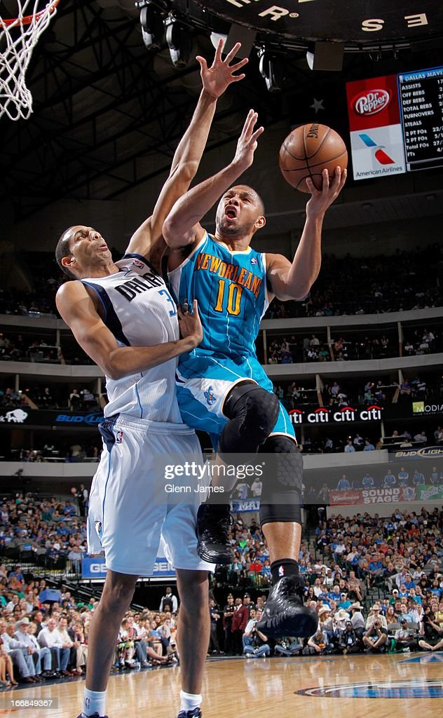 Eric Gordon #10 of the New Orleans Hornets shoots against Brandan Wright #34 of the Dallas Mavericks on April 17, 2013 at the American Airlines Center in Dallas, Texas.