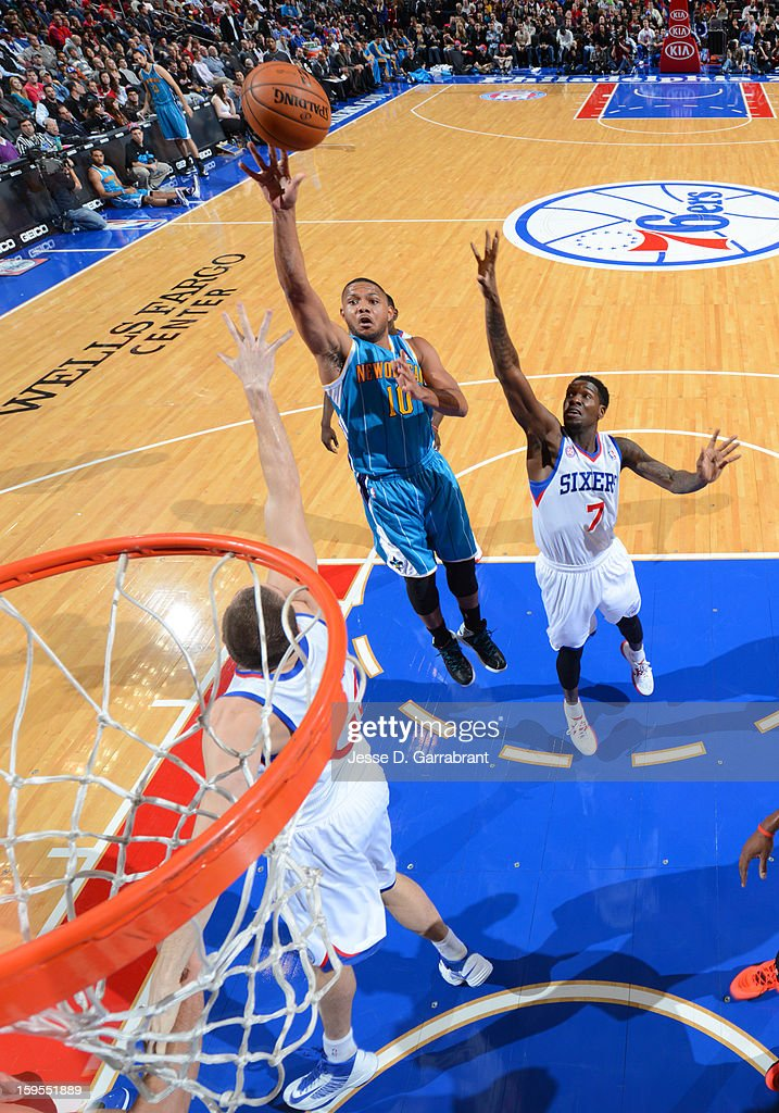Eric Gordon #10 of the New Orleans Hornets shoots against Royal Ivey #7 of the Philadelphia 76ers during the game at the Wells Fargo Center on January 15, 2013 in Philadelphia, Pennsylvania.