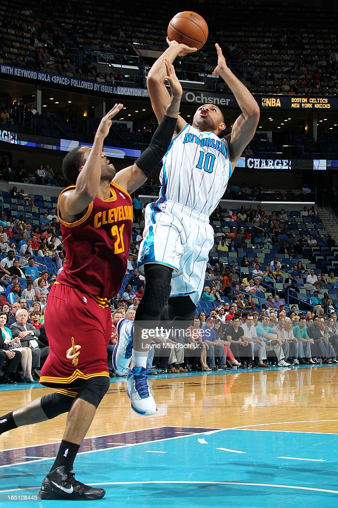 <a gi-track='captionPersonalityLinkClicked' href=/galleries/search?phrase=Eric+Gordon&family=editorial&specificpeople=4212733 ng-click='$event.stopPropagation()'>Eric Gordon</a> #10 of the New Orleans Hornets shoots against <a gi-track='captionPersonalityLinkClicked' href=/galleries/search?phrase=Wayne+Ellington&family=editorial&specificpeople=2351537 ng-click='$event.stopPropagation()'>Wayne Ellington</a> #21 of the Cleveland Cavaliers on March 31, 2013 at the New Orleans Arena in New Orleans, Louisiana.