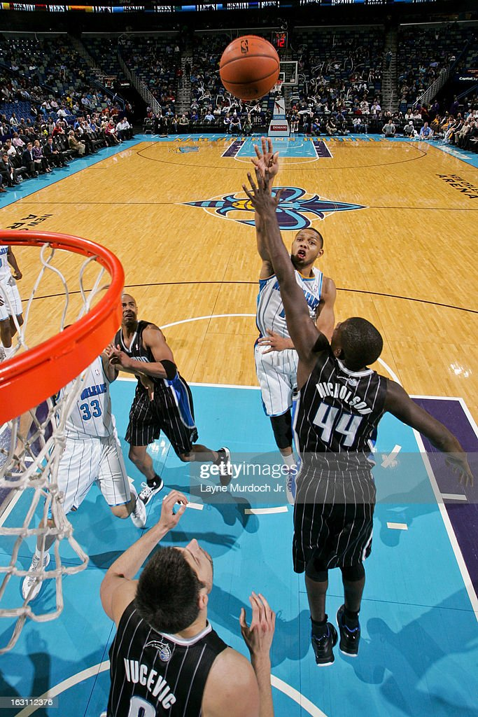 <a gi-track='captionPersonalityLinkClicked' href=/galleries/search?phrase=Eric+Gordon&family=editorial&specificpeople=4212733 ng-click='$event.stopPropagation()'>Eric Gordon</a> #10 of the New Orleans Hornets shoots in the lane against Andrew Nicholson #44 of the Orlando Magic on March 4, 2013 at the New Orleans Arena in New Orleans, Louisiana.