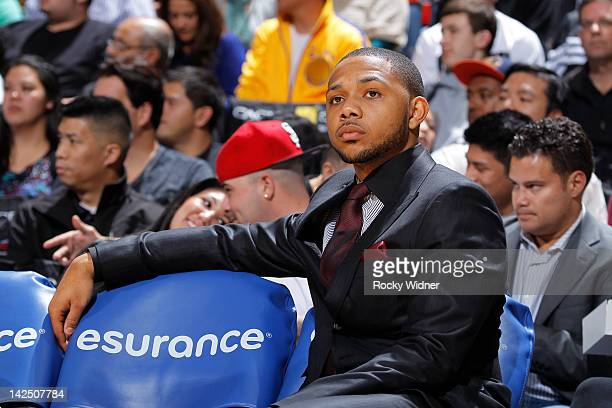 Eric Gordon of the New Orleans Hornets watches his team play the Golden State Warriors on March 28 2012 at Oracle Arena in Oakland California NOTE TO...