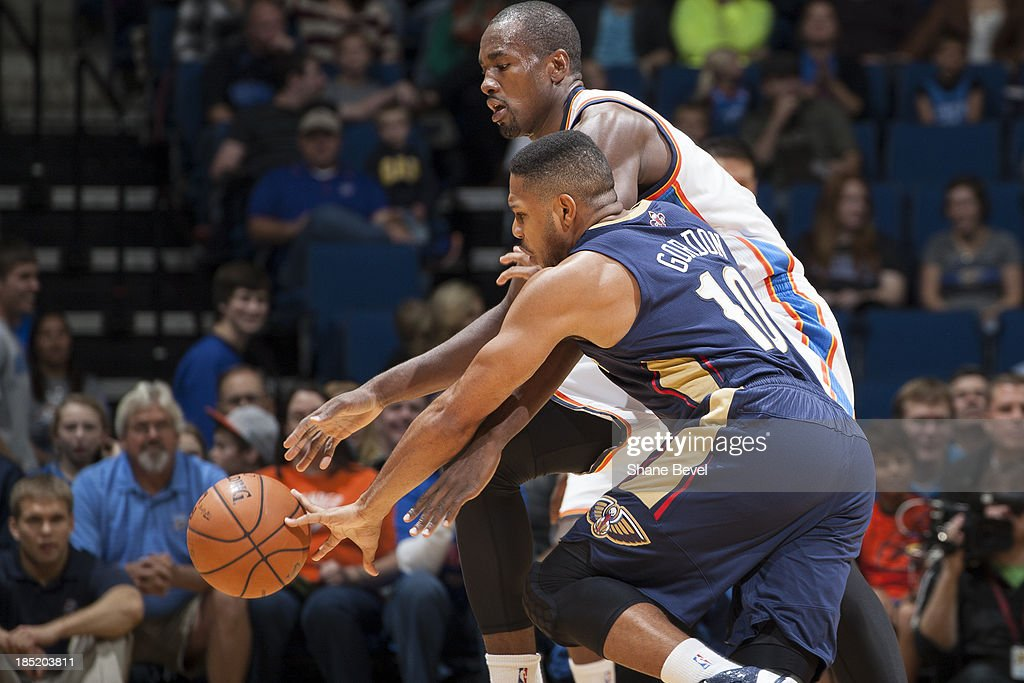 <a gi-track='captionPersonalityLinkClicked' href=/galleries/search?phrase=Eric+Gordon&family=editorial&specificpeople=4212733 ng-click='$event.stopPropagation()'>Eric Gordon</a> # 10 of the New Orleans Pelicans and <a gi-track='captionPersonalityLinkClicked' href=/galleries/search?phrase=Serge+Ibaka&family=editorial&specificpeople=5133378 ng-click='$event.stopPropagation()'>Serge Ibaka</a> # 9 of the Oklahoma City Thunder fight for the ball during the NBA preseason game on October 17, 2013 at the BOK Center in Tulsa, Oklahoma.