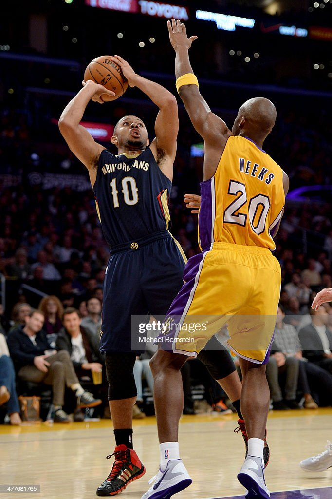 Eric Gordon #10 of the New Orleans Pelicans attempts a shot against the Los Angeles Lakers at Staples Center on November 12, 2013 in Los Angeles, California.