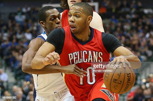 Eric Gordon of the New Orleans Pelicans dribbles the ball against Rajon Rondo of the Dallas Mavericks at American Airlines Center on March 2 2015 in...