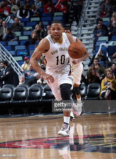 Eric Gordon of the New Orleans Pelicans dribbles up the court against the Washington Wizards during an NBA game on January 8 2014 at the New Orleans...