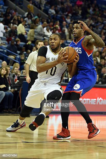 Eric Gordon of the New Orleans Pelicans drives around Larry Drew II of the Philadelphia 76ers during the first half of a game at the Smoothie King...