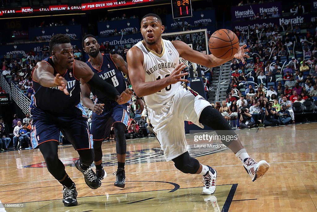 <a gi-track='captionPersonalityLinkClicked' href=/galleries/search?phrase=Eric+Gordon&family=editorial&specificpeople=4212733 ng-click='$event.stopPropagation()'>Eric Gordon</a> #10 of the New Orleans Pelicans drives to the basket against <a gi-track='captionPersonalityLinkClicked' href=/galleries/search?phrase=Jeff+Adrien&family=editorial&specificpeople=727235 ng-click='$event.stopPropagation()'>Jeff Adrien</a> #4 of the Charlotte Bobcats on November 2, 2013 at the New Orleans Arena in New Orleans, Louisiana.