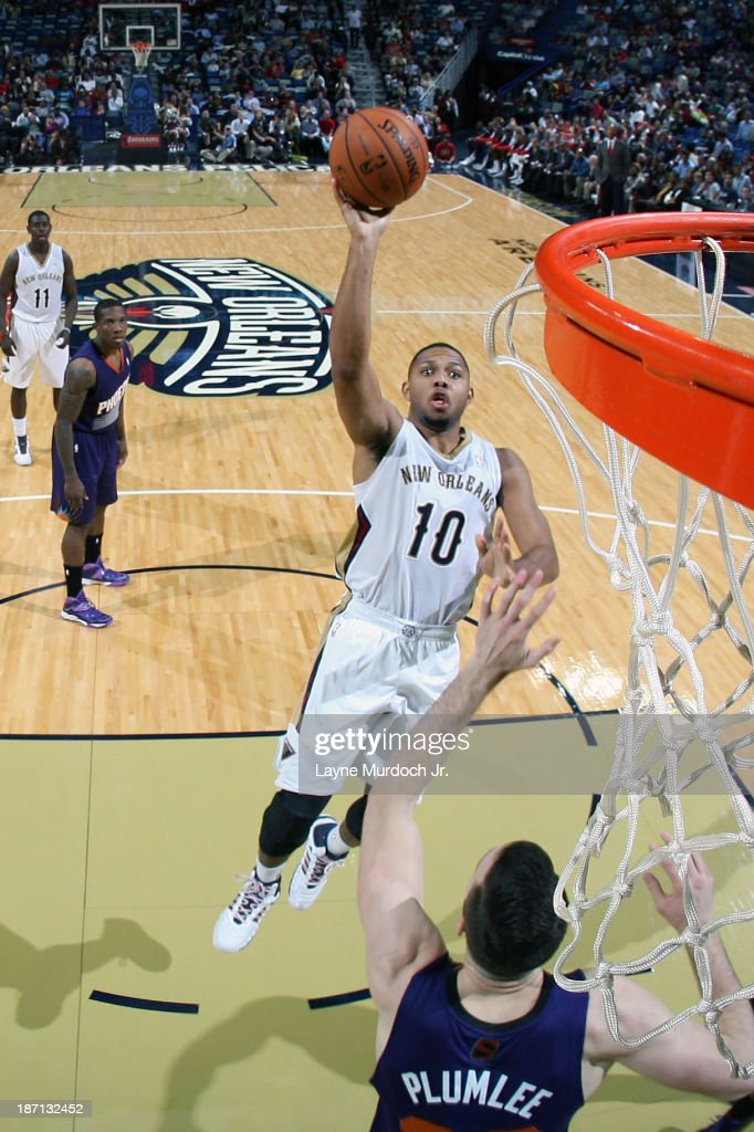 <a gi-track='captionPersonalityLinkClicked' href=/galleries/search?phrase=Eric+Gordon&family=editorial&specificpeople=4212733 ng-click='$event.stopPropagation()'>Eric Gordon</a> #10 of the New Orleans Pelicans drives to the basket against the Phoenix Suns on November 5, 2013 at the New Orleans Arena in New Orleans, Louisiana.