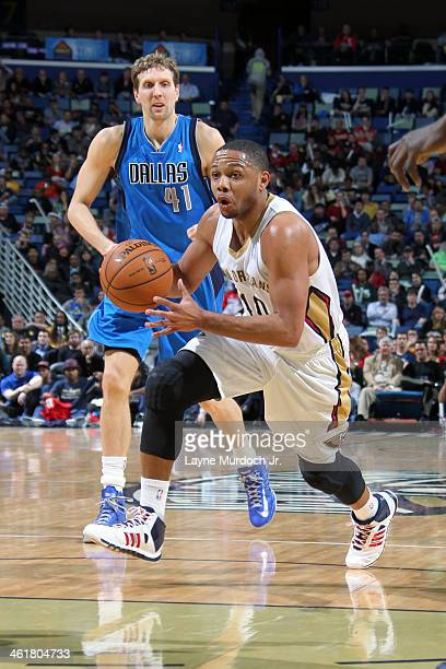 Eric Gordon of the New Orleans Pelicans drives to the basket against the Dallas Mavericks on January 10 2014 at the New Orleans Arena in New Orleans...