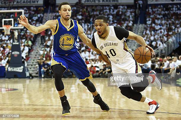 Eric Gordon of the New Orleans Pelicans drives to the basket against Stephen Curry of the Golden State Warriors during Game Four in the first round...