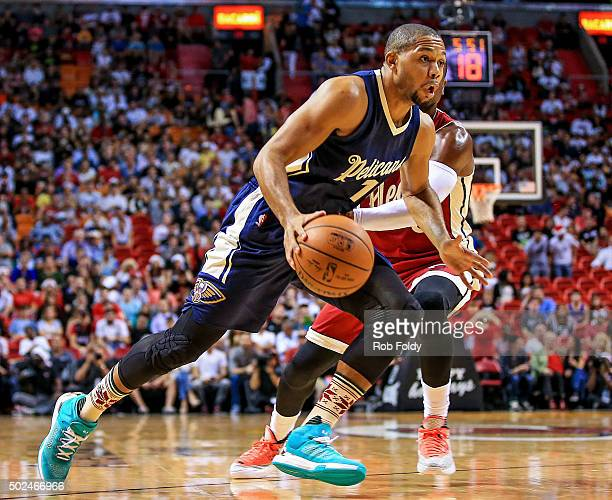 Eric Gordon of the New Orleans Pelicans drives to the basket during the game against the Miami Heat at American Airlines Arena on December 25 2015 in...