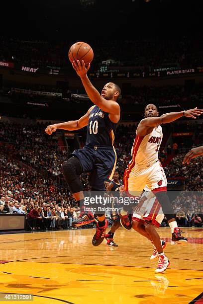 Eric Gordon of the New Orleans Pelicans goes up for the layup against the Miami Heat at the American Airlines Arena in Miami Florida on Jan 7 2014...