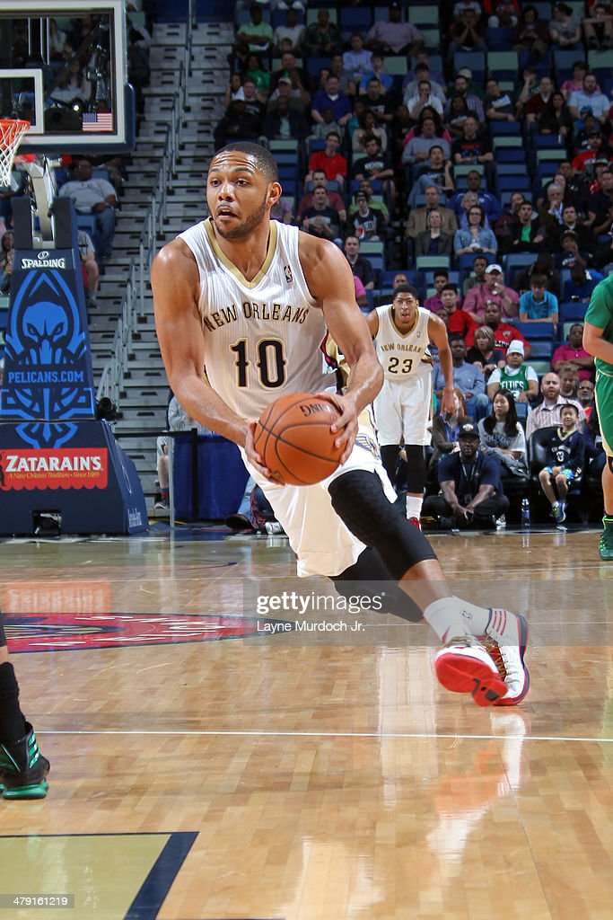 <a gi-track='captionPersonalityLinkClicked' href=/galleries/search?phrase=Eric+Gordon&family=editorial&specificpeople=4212733 ng-click='$event.stopPropagation()'>Eric Gordon</a> #10 of the New Orleans Pelicans goes up for the layup against the Boston Celtics during an NBA game on March 16, 2014 at the Smoothie King Center in New Orleans, Louisiana.