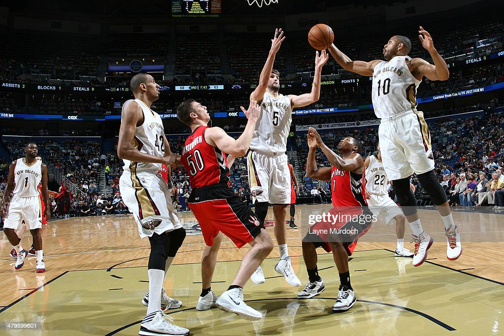 <a gi-track='captionPersonalityLinkClicked' href=/galleries/search?phrase=Eric+Gordon&family=editorial&specificpeople=4212733 ng-click='$event.stopPropagation()'>Eric Gordon</a> #10 of the New Orleans Pelicans grabs a rebound against the Toronto Raptors during an NBA game on March 19, 2014 at the Smoothie King Center in New Orleans, Louisiana.