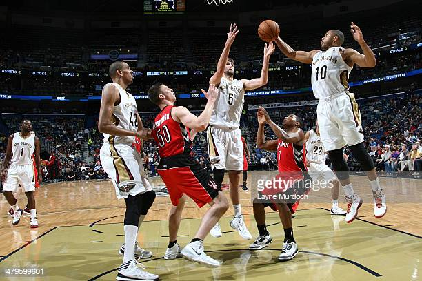 Eric Gordon of the New Orleans Pelicans grabs a rebound against the Toronto Raptors during an NBA game on March 19 2014 at the Smoothie King Center...