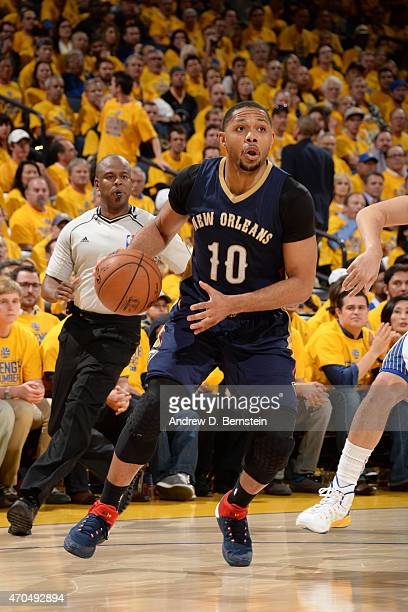Eric Gordon of the New Orleans Pelicans handles the ball against the Golden State Warriors during Game Two of the Western Conference Quarterfinals of...